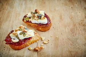 toasted bread slices with jam and brie cheese