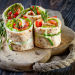 26439425 - salmon lavash rolls with fresh salad leafs
